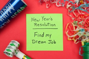 New Years resolution to find dream job on a sticky note. Party favors and confetti border the memo.
